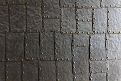 Steel plate door texture. Close-up of steel plates strung together - plating of a door in an old castle Stock Images
