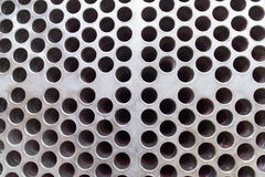Steel plate with holes Royalty Free Stock Images