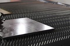 a steel plate on machine , ready for processing royalty free stock photos