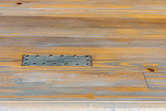 Steel plate nailed to wood Royalty Free Stock Images