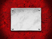 Free Steel Plate On A Red Grunge Background Stock Photo - 2077470