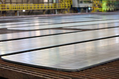 Steel plate on production line. In steel plant stock photography