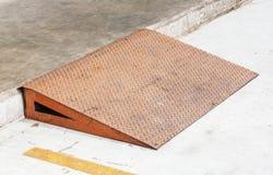 Steel plate ramp. Grunge diamond steel plate ramp in car garage Royalty Free Stock Images