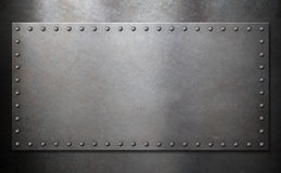 Steel plate with rivets over metal background stock photography