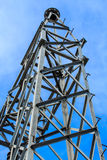 Steel poles. High voltage power pole at large . With blue sky stock image