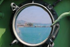 Steel porthole of warship Stock Photography