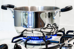 A steel pot on the stove Royalty Free Stock Photo