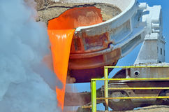Steel is poured into the slag dump Stock Image