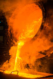 Steel pouring. Hot steel pouring at the steel plant Stock Photos