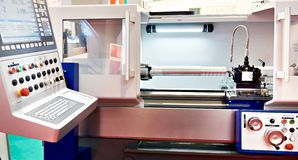 Steel product in CNC lathe. Steel product in the CNC lathe stock images
