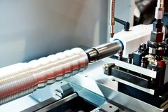 Steel product in lathe. Steel product in the lathe royalty free stock images
