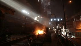 Steel production in electric furnaces. Huge ironworks. stock video footage