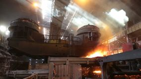 Steel production in electric furnaces. Huge ironworks. stock footage