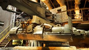 Steel production at the metallurgical plant, heavy industry concept. Stock footage. Close up for the bucket for feeding. Steel production at the metallurgical stock images