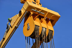 Steel pulley at work in construction site Stock Images