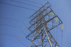 Steel pylon for high voltage power lines against blue sky Stock Photo