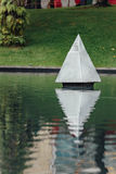 Steel Pyramid sculpture in the park`s pool near Petronas twin towers in Kuala Lumpur, Malaysia Stock Photo