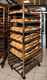 Steel rack with bread, commercial kitchen Royalty Free Stock Images