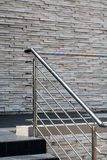 Steel railings, stone walls. An image of steel railings following along the passage and steps with a gray stone wall in the background Royalty Free Stock Image