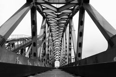 Steel railroad bridge. In black and white Royalty Free Stock Image