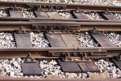 Steel railroad tracks on wooden beams. Stones and tracks Royalty Free Stock Images