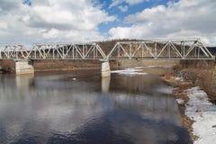Steel railway bridge over the river Chulman. In South Yakutia, Russia Stock Image