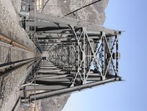 Steel railway bridge into tunnel in the moutain Royalty Free Stock Image