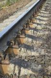 Steel railway rails. Concrete cross ties, gravel Royalty Free Stock Photography