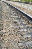 Steel railway rails. Concrete cross ties, gravel Royalty Free Stock Images