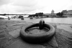 Steel ring for mooring on the waterfront of the River Seine in Paris. Royalty Free Stock Image