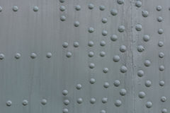 Steel riveted surface Stock Images
