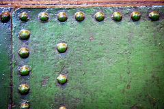 Steel and rivets. Grained abstract industrial metal plates with rivets Stock Photography