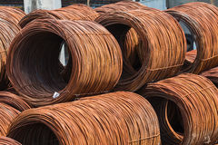 Steel Rod Rolls Stacked. In yard for reinforcing strength for concrete infrastructure construction Stock Image