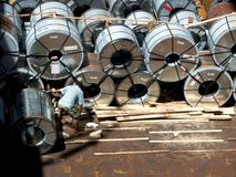 Steel roll coil in hold. Stock Photos