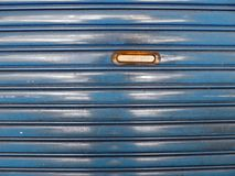 Steel roll up door with mailbox Stock Image