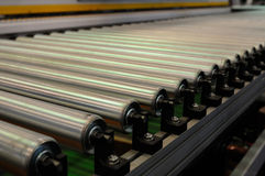 Steel roller conveyer. Steel rollers on a conveyer royalty free stock photography