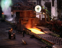 Steel rolling. Smelting steels in heavy industry factory Stock Photos
