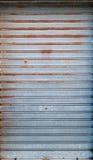 Steel rolling shutter of closed door, texture Stock Image