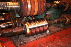 Steel rolls. Spare steel rolls in steelworks rolling mill store Royalty Free Stock Photography