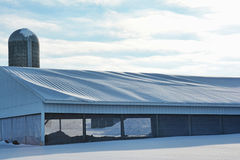 Steel Roof Ag Building with Snow Stock Photo