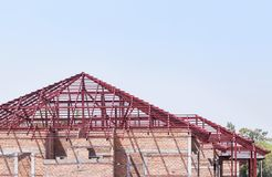 Steel roof frame structures. In residential construction site stock photography