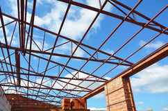 Steel roof trusses details with clouds sky background. Industrial roofing. Stock Photography