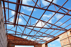 Steel roof trusses details with clouds sky background. Steel roo Royalty Free Stock Images