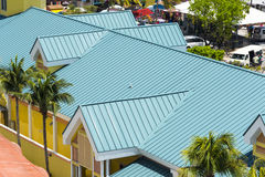 Steel Roofing Green. Steel roofing on modern apartment condo building for hurricane protection stock image