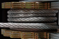 Steel rope on spool with ratchet. Part of winch Stock Photo