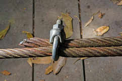 Steel ropes. Old two steel ropes connected by loose strap Stock Photo