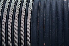 Steel ropes wound on a shaft, abstract industrial background Stock Image