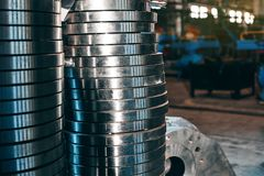 Steel round billets for the manufacture of valves. For the gas and petroleum industry at a machine-building plant stock photos