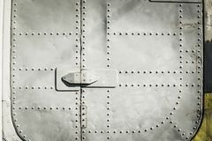 Steel Round Head Rivets in sheet aluminium body of aircraft.  stock image
