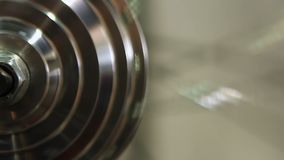 Steel round object rotating indefinitely, eternal motion, everyday routine. Stock footage stock video footage